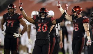 San Diego State running back Rashaad Penny (20) reacts with teammates during the final minute of the second half of an NCAA college football game against Stanford Saturday, Sept. 16, 2017, in San Diego. San Diego State won 20-17. (AP Photo/Gregory Bull)