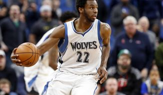 FILE - In this March 13, 2017, file photo, Minnesota Timberwolves' Andrew Wiggins plays during the second half of an NBA basketball game against the Washington Wizards in Minneapolis. Wiggins says he feels good about a max contract offer that is sitting in front of him with the Minnesota Timberwolves. (AP Photo/Jim Mone, File)