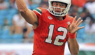 FILE - In this Saturday, Sept. 2, 2017, file photo, Miami quarterback Malik Rosier (12) passes against Bethune-Cookman during an NCAA college football game in Miami Gardens, Fla. Rosier will be making his third career start when Miami faces Toledo, Saturday, Sept. 23, 2017. (Al Diaz/Miami Herald via AP, File)