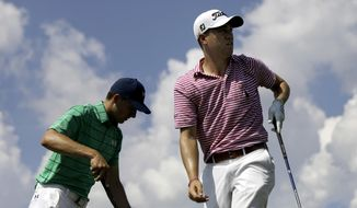 Justin Thomas, right, watches his shot after teeing off on the sixth hole as Jordan Spieth steps up to hit during the second round of the Tour Championship golf tournament at East Lake Golf Club in Atlanta, Friday, Sept. 22, 2017. (AP Photo/David Goldman)