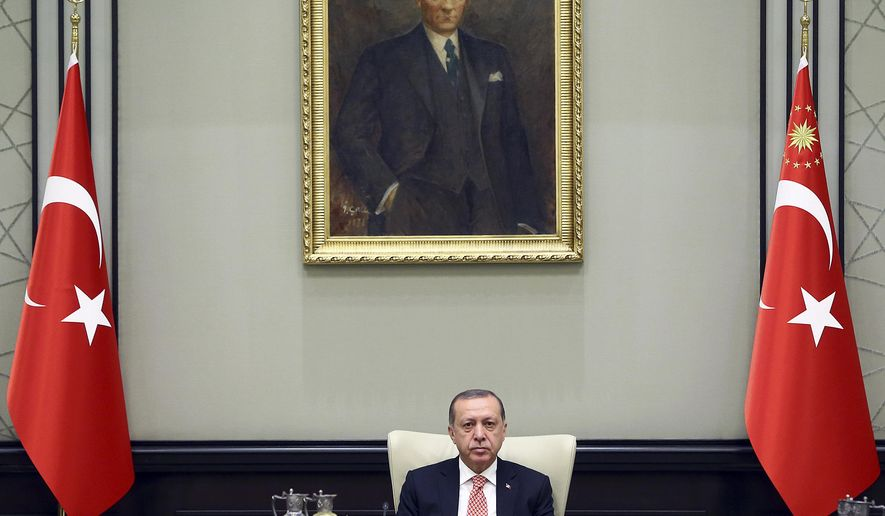 Turkey's President Recep Tayyip Erdogan chairs the National Security Council in Ankara, Turkey, Friday, Sept. 22, 2017. Turkey's political and military leaders met to consider possible sanctions and other measures against Iraq's Kurdish region if it goes ahead with a referendum for independence. The Council met followed by a Cabinet meeting on Friday as the country stepped up pressure on Iraq's Kurds to abandon the vote slated for Sept. 25. (Presidential Press Service, pool photo via AP)
