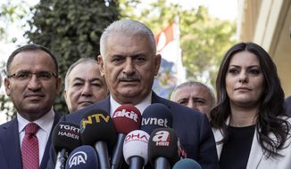 "Turkish Prime Minister Binali Yildirim speaks to the media in Ankara, Turkey, Friday Sept. 22, 2017. Yildirim said Friday his country will never accept a separate Kurdish state in neighboring Iraq and would not refrain from taking steps to prevent it. Binali Yildirim again called on Iraqi Kurdish leaders to abandon plans for a referendum on independence, saying it was not too late for them to turn away ""from this adventure."" (Turkish Prime Ministry, pool photo via AP)"