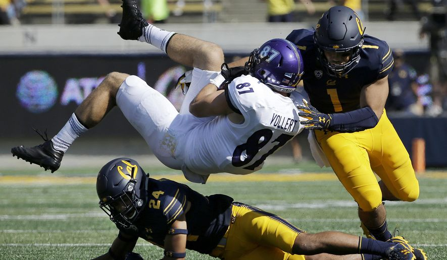 FILE - In this Sept. 9, 2017, file photo, Weber State tight end Andrew Vollert (87) is tackled after catching a pass between California cornerback Camryn Bynum (24) and linebacker Devante Downs (1) during the first half of an NCAA college football game in Berkeley, Calif. This week, California faces Southern California. California coach Justin Wilcox is a former USC defensive coordinator. (AP Photo/Jeff Chiu, File)