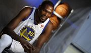 Golden State Warriors' Kevin Durant conducts an interview during NBA basketball team media day Friday, Sept. 22, 2017, in Oakland, Calif. (AP Photo/Marcio Jose Sanchez)
