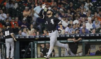 Chicago White Sox's Yoan Moncada gestures after hitting a two-run home run against the Houston Astros during the fourth inning of a baseball game Wednesday, Sept. 20, 2017, in Houston. (AP Photo/David J. Phillip)
