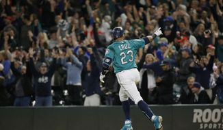 Seattle Mariners' Nelson Cruz  points to fans as he runs the bases after hitting a walk-off home run to score Robinson Cano in the ninth inning of a baseball game against the Cleveland Indians, Friday, Sept. 22, 2017, in Seattle. The Mariners won 3-1. (AP Photo/Ted S. Warren)