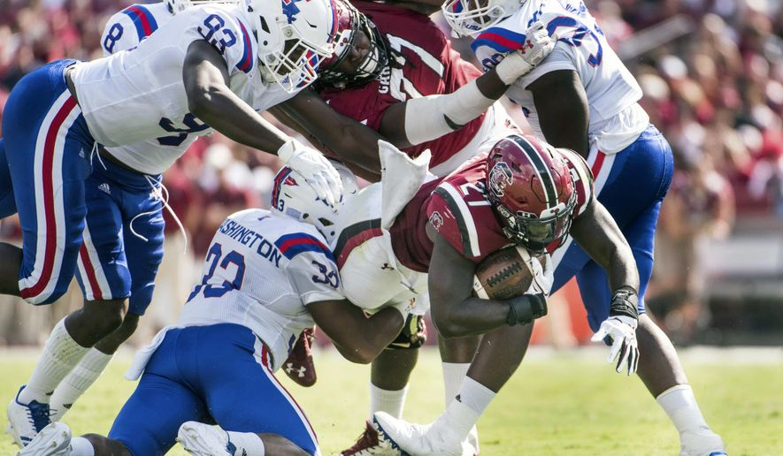South Carolina running back Ty'Son Williams (27) carries the ball against Louisiana Tech linebacker Dae'Von Washington (33), Immanuel Turner (93) and Keonatye Garner (99) during the first half of an NCAA college football game Saturday, Sept. 23, 2017, in Columbia, S.C. (AP Photo/Sean Rayford)