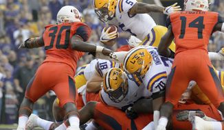 LSU running back Derrius Guice (5) scores a touchdown in the first half against Syracuse in an NCAA college football game in Baton Rouge, La., Saturday, Sept. 23, 2017. (AP Photo/Matthew Hinton)