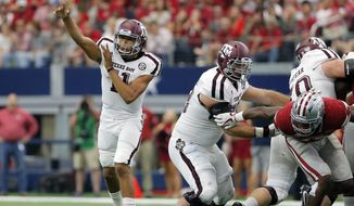 Texas A&M quarterback Kellen Mond (11) throws a pass in the second half of an NCAA college football game against Arkansas on Saturday, Sept. 23, 2017, in Arlington, Texas. (AP Photo/Tony Gutierrez)