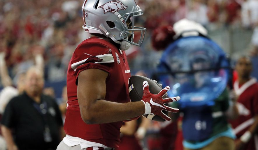 Arkansas wide receiver Jared Cornelius (1) catches a pass in the end zone for a touchdown in the first half of an NCAA college football game against Texas A&M, Saturday, Sept. 23, 2017, in Arlington, Texas. (AP Photo/Tony Gutierrez)
