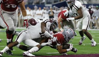 Arkansas running back Chase Hayden (2) dives into the end zone for a touchdown under the attempted stop by Texas A&M defensive back Myles Jones (10) in the first half of an NCAA college football game, Saturday, Sept. 23, 2017, in Arlington, Texas. (AP Photo/Tony Gutierrez)