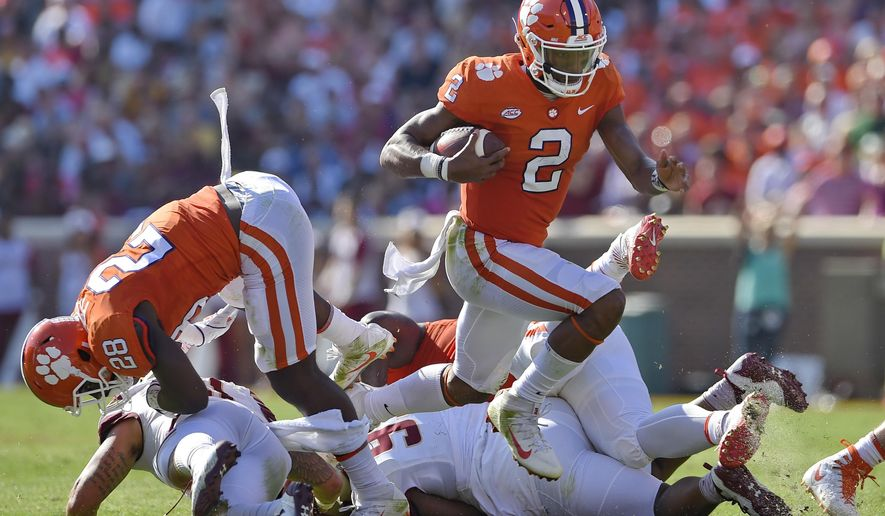 Clemson quarterback Kelly Bryant (2) rushes for a first down with blocking help from Tavien Feaster during the first half of an NCAA college football game against Boston College, Saturday, Sept. 23, 2017, in Clemson, S.C. Clemson won 34-7. (AP Photo/Richard Shiro)