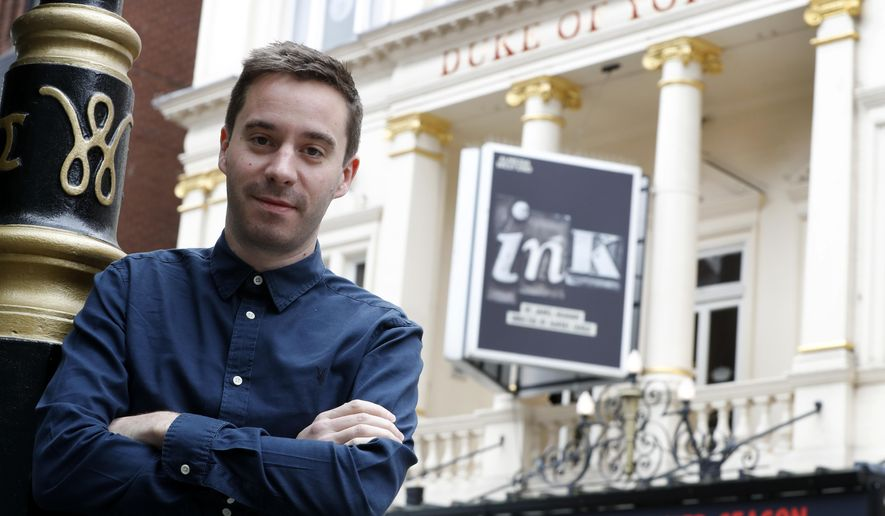 """In this Thursday, Sept. 21, 2017 photo, British playwright James Graham poses for a photograph, outside The Duke of York's Theatre which is currently showing his play 'Ink', in London. Rupert Murdoch has power, wealth _ and legions of detractors, who say the media mogul's tabloids and TV stations have fueled crass celebrity culture, phone hacking and fake news. A new play in London explores the roots of his success and his divisiveness. Ink"""" shows how Murdoch revolutionized British journalism, turning the failing Sun newspaper into the country's most influential tabloid through a mix of sin, sensation and sex. (AP Photo/Kirsty Wigglesworth)"""