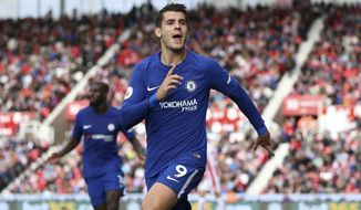 Chelsea's Alvaro Morata scores his side's forth goal of the game during the English Premier League soccer match between Stoke City and Chelsea at the bet365 Stadium, Stoke-on-Trent, England, Saturday, Sept. 23, 2017. (Nigel French/PA via AP)