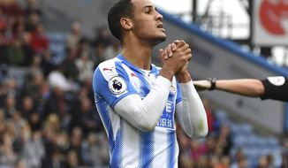 Huddersfield Tom Ince gestures, during the English Premier League soccer match between Burnley and Huddersfield, at Turf Moor, in Burnley, England, Saturday Sept.  23, 2017. (Anthony Devlin/PA via AP)
