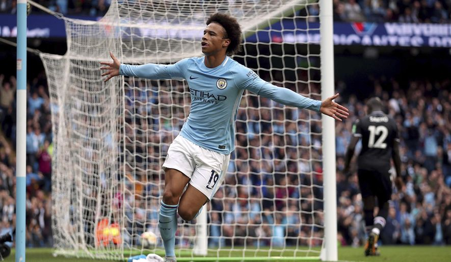 Manchester City's Leroy Sane celebrates scoring his side's first goal of the game, during the English Premier League soccer match between Manchester City and Crystal Palace, at the Etihad Stadium, in Manchester, England,  Saturday, Sept. 23, 2017. (Nick Potts/PA  via AP)
