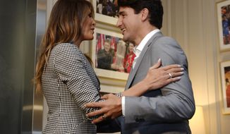 Prime Minister Justin Trudeau welcomes United States first lady Melania Trump prior to the opening ceremonies of the Invictus Games in Toronto on Saturday, Sept. 23, 2017. (Nathan Denette/The Canadian Press via AP)