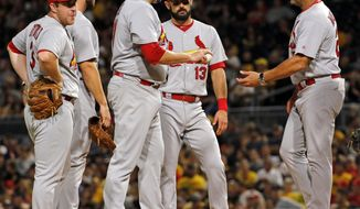 St. Louis Cardinals manager Mike Matheny, right, takes the ball from starting pitcher Lance Lynn in the first inning of a baseball game against the Pittsburgh Pirates, Saturday, Sept. 23, 2017 in Pittsburgh. (AP Photo/Gene J. Puskar)