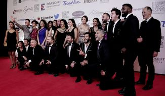 "Cast members and makers of the film ""Sheikh Jackson"" pose for a photograph on the red carpet during the first International El Gouna Film Festival, in the Red Sea resort of el-Gouna, Egypt, Friday, Sept. 22, 2017. The film which is to be released in Egyptian cinemas later this month and which Egypt has put forward as a candidate for a best foreign film Oscar nomination, goes into delicate territory. The film risks a backlash from the public, either by viewers who see as it as too sympathetic to Islamists or, from the other side, as mocking religious beliefs. (AP Photo/Nariman El-Mofty)"