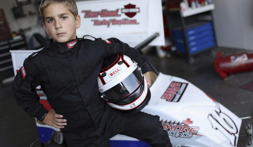 ADVANCE FOR SATURDAY, SEPT. 23 AND THEREAFTER  - Eight-year-old Ian Steward with his Outlaw Cage Kart, Friday Sept. 8, 2017, at his home in West Burlington, Iowa. Steward, a fourth generation racer recently won the English Creek Speedway 2017 Outlaw Dirt Kart Nationals Restricted Box Stock Division Champion trophy. ( John Lovretta/The Hawk Eye via AP)