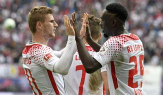 Leipzig's Timo Werner, left, celebrates together with first goal scorer Leipzig's Jean-Kevin Augustin after he scoring a goal during the German first division Bundesliga soccer match between RB Leipzig and Eintracht Frankfurt in Leipzig, central Germany, Saturday, Sept. 23, 2017. (AP Photo/Jens Meyer)