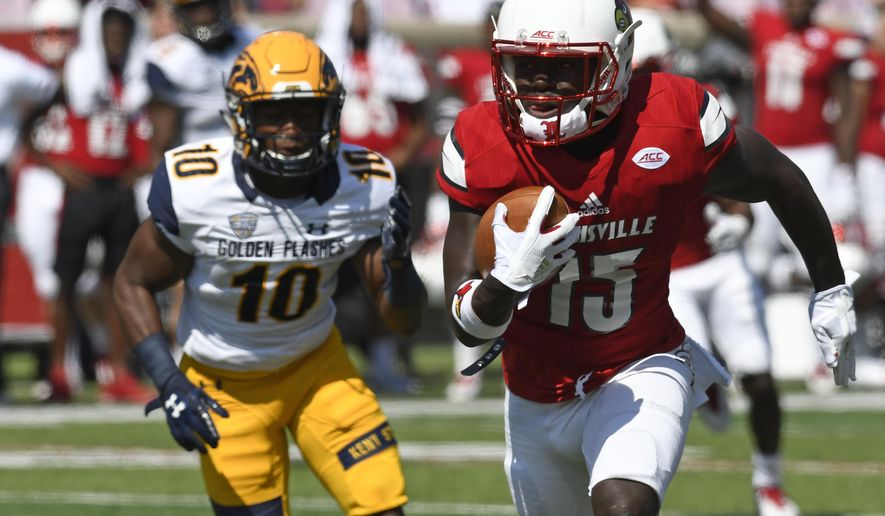 Louisville's Trumaine Washington (15) is pursued by Kent State's wide receiver Kavious Price (10) following his interception during the first half of an NCAA college football game, Saturday, Sept. 23, 2017, in Louisville, Ky. (AP Photo/Timothy D. Easley)