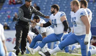 FILE - In this Aug. 31, 2017, file photo, Detroit Lions coach Jim Caldwell shakes hands with defensive end Giorgio Newberry (64) before the team's preseason NFL football game against the Buffalo Bills in Orchard Park, N.Y. The Lions confirmed Saturday they signed Caldwell to a multiyear deal months ago. Caldwell has a 29-21 record in Detroit over three-plus seasons. He is 0-2 in the playoffs with a franchise that has won only one playoff game in six decades. (AP Photo/Adrian Kraus, File)