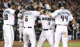Arizona Diamondbacks' Chris Iannetta (8) is congratulated by teammates J.D. Martinez (28), David Peralta (6) and Paul Goldschmidt (44) after hitting a grand slam against the Miami Marlins during the sixth inning of a baseball game, Friday, Sept. 22, 2017, in Phoenix. It was Iannetta's second home run of the game. (AP Photo/Ralph Freso)