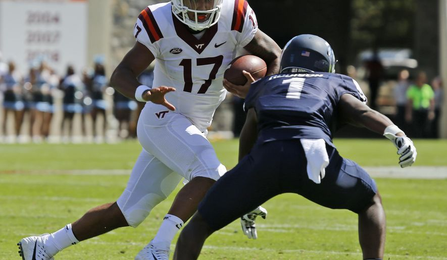 Virginia Tech quarterback Josh Jackson (17) tries to elude Old Dominion cornerback Brandon Addison (1) during the first half of the Old Dominion Virginia Tech NCAA college football game in Blacksburg, Va., Saturday, Sept. 23, 2017. (AP Photo/Steve Helber)