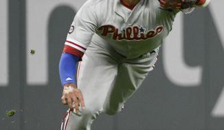 Philadelphia Phillies Left Fielder Aaron Altherr Catches A