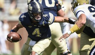 Pittsburgh quarterback Max Browne scrambles against Georgia Tech linebacker Victor Alexander (9) during the second half of an NCAA college football game, Saturday, Sept. 23, 2017, in Atlanta. Georgia Tech won 35-17. (AP Photo/Jon Barash)