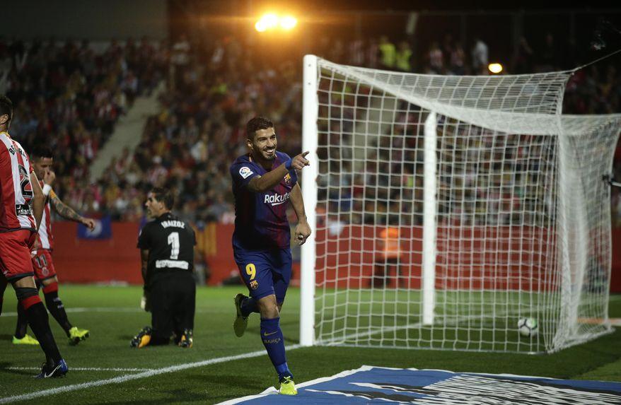FC Barcelona's Luis Suarez, celebrates a goal during the Spanish La Liga soccer match between Girona and FC Barcelona at the Montilivi stadium in Girona, Spain, Saturday, Sept. 23, 2017. (AP Photo/Manu Fernandez)