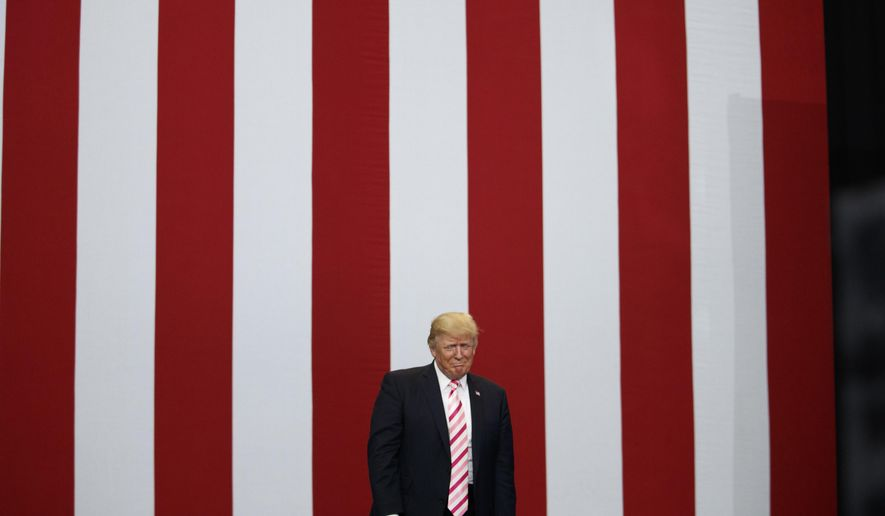 President Donald Trump arrives for a campaign rally for U.S. Senate candidate Luther Strange, Friday, Sept. 22, 2017, in Huntsville, Ala. (AP Photo/Evan Vucci)