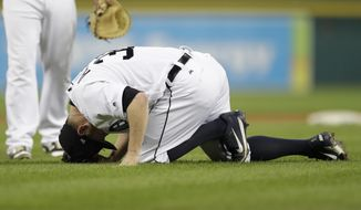 Detroit Tigers relief pitcher Alex Wilson reacts after being hit by a ball during the eighth inning of a baseball game against the Minnesota Twins, Saturday, Sept. 23, 2017, in Detroit. (AP Photo/Carlos Osorio)