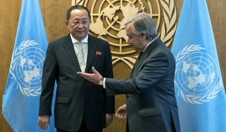 North Korean Foreign Minister Ri Yong Ho, left, is greeted by United Nations Secretary-General Antonio Guterres before a meeting, Saturday, Sept. 23, 2017, at U.N. headquarters. (AP Photo/Craig Ruttle)