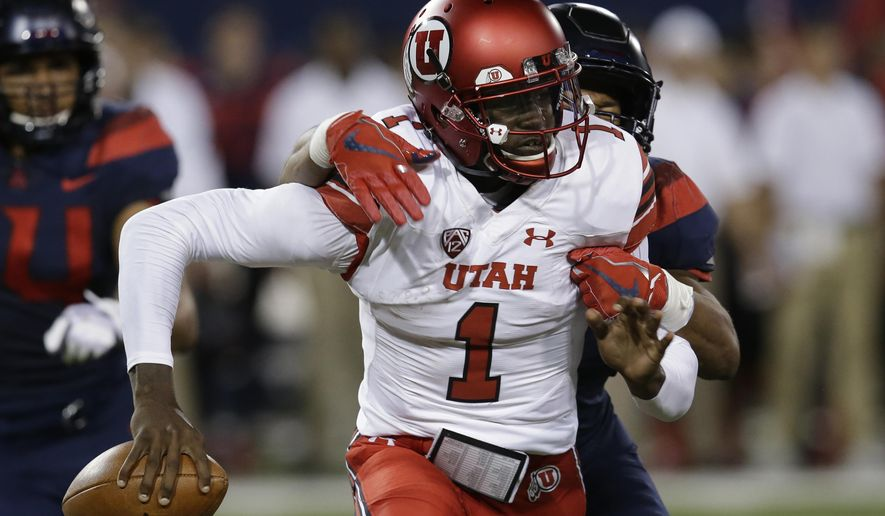 Arizona linebacker Tony Fields II tackles Utah quarterback Tyler Huntley (1) during the first half during an NCAA college football game, Friday, Sept. 22, 2017, in Tucson, Ariz. Huntley left the game with an injury. (AP Photo/Rick Scuteri)