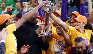 FILE - In this Oct. 20, 2016, file photo, Los Angeles Sparks players celebrate after winning the WNBA championship title with a 77-76 win over the Minnesota Lynx in Game 5 in Minneapolis. Last year's WNBA Finals were so good they're doing it all over again. The defending champion Los Angeles Sparks play the Minnesota Lynx, who are in the finals for the sixth time in the last seven years. Game 1 is on Sunday in Minneapolis. (AP Photo/Jim Mone, File)