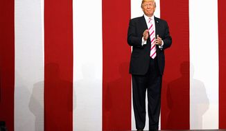 President Trump arrives to speak at a campaign rally for Sen. Luther Strange on Friday in Huntsville, Alabama. (Associated Press)