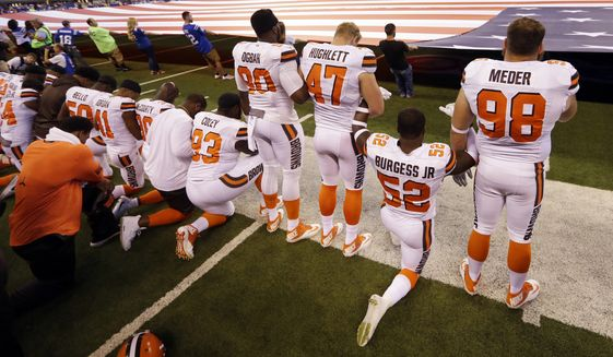 Some members of the Cleveland Browns were among the NFL players who took a knee during the national anthem before games on Sunday. (Associated Press/File)