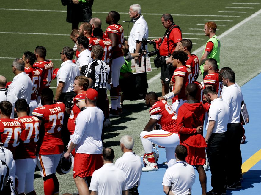 Members of the Kansas City Chiefs sit in protest during the National Anthem before an NFL football game against the Los Angeles Chargers Sunday, Sept. 24, 2017, in Carson, Calif. (AP Photo/Chris Carlson)