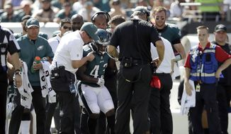 Philadelphia Eagles' Darren Sproles is helped up after an injury during the first half of an NFL football game against the New York Giants, Sunday, Sept. 24, 2017, in Philadelphia. (AP Photo/Matt Rourke)