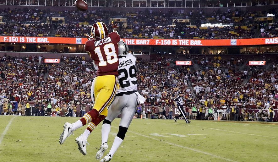 Washington Redskins wide receiver Josh Doctson (18) pulls in a touchdown pass under pressure form Oakland Raiders cornerback David Amerson (29) during the second half of an NFL football game in Landover, Md., Sunday, Sept. 24, 2017. (AP Photo/Alex Brandon)