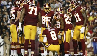 Washington Redskins quarterback Kirk Cousins (8) leads the huddle during the first half of an NFL football game against the Oakland Raiders in Landover, Md., Sunday, Sept. 24, 2017. (AP Photo/Pablo Martinez Monsivais)
