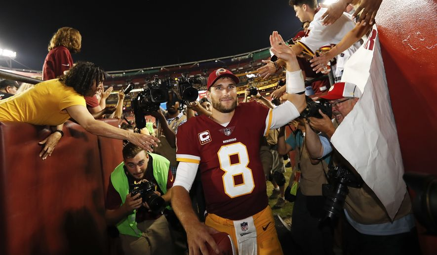 Washington Redskins quarterback Kirk Cousins (8) is greeted by fans as he leave the field after an NFL football game against the Oakland Raiders in Landover, Md., Sunday, Sept. 24, 2017. The Redskins defeated the Raiders 27-10. (AP Photo/Alex Brandon)