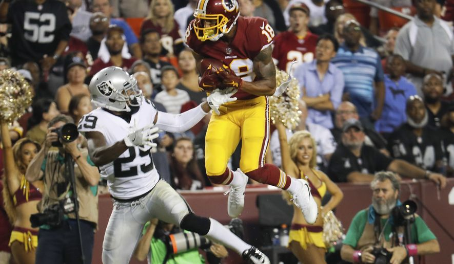 Washington Redskins wide receiver Josh Doctson (18) pulls in a touchdown pass as Oakland Raiders cornerback David Amerson (29) looks back at him during the second half of an NFL football game in Landover, Md., Sunday, Sept. 24, 2017. (AP Photo/Pablo Martinez Monsivais)
