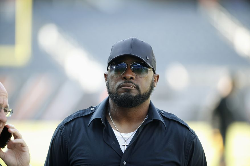 Pittsburgh Steelers head coach Mike Tomlin walks around the field as players warm up before an NFL football game against the Chicago Bears, Sunday, Sept. 24, 2017, in Chicago. (AP Photo/Charles Rex Arbogast)