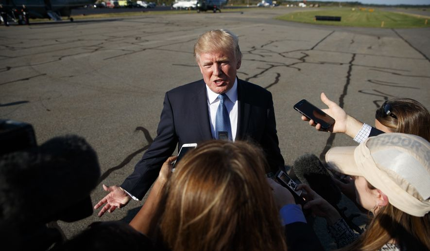 President Donald Trump speaks with reporters before boarding Air Force One at Morristown Municipal airport, Sunday, Sept. 24, 2017, in Morristown, N.J. (AP Photo/Evan Vucci)