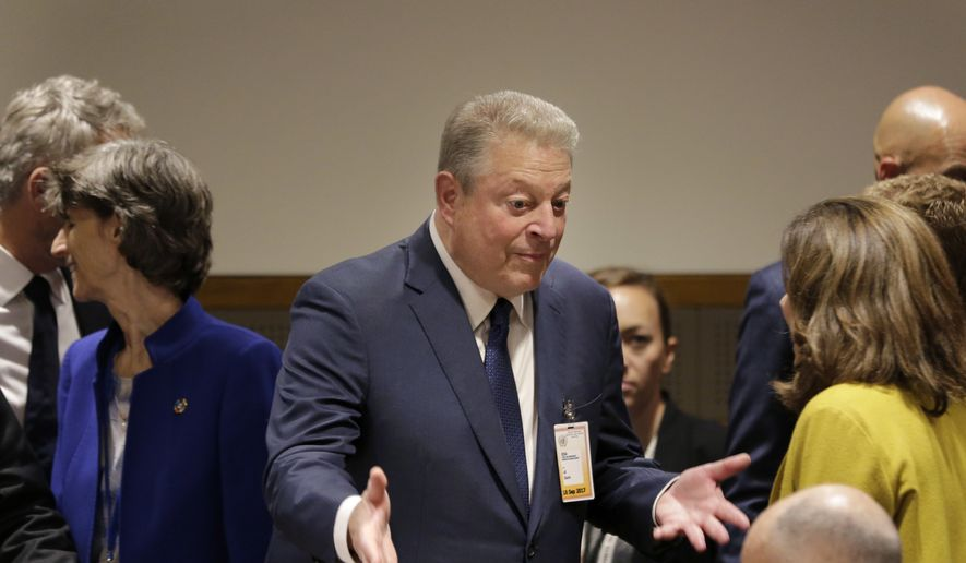 Al Gore speaks to people before a meeting on climate change during the United Nations General Assembly at U.N. headquarters, Monday, Sept. 18, 2017. (AP Photo/Seth Wenig)