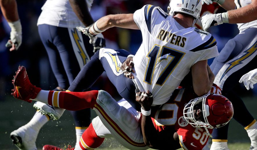 Kansas City Chiefs outside linebacker Justin Houston (50) sacks Los Angeles Chargers quarterback Philip Rivers during the second half of an NFL football game Sunday, Sept. 24, 2017, in Carson, Calif. (AP Photo/Jae C. Hong)