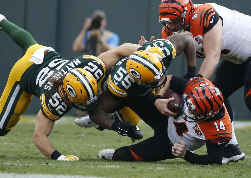 Cincinnati Bengals' Andy Dalton is sacked by Green Bay Packers' Ahmad Brooks (55) and Clay Matthews (52) during the second half of an NFL football game Sunday, Sept. 24, 2017, in Green Bay, Wis. (AP Photo/Mike Roemer)